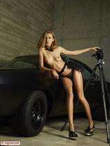 Sexy girl posing on a car 01