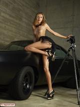 Sexy girl posing on a car 02