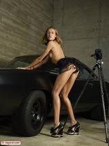 Sexy girl posing on a car 03