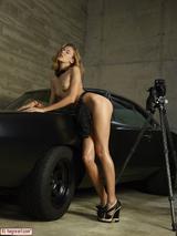 Sexy girl posing on a car 14