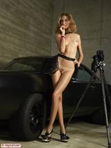Sexy girl posing on a car 15