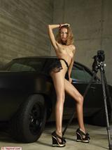 Sexy girl posing on a car 17