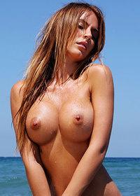 Beautiful Alexa naked on the shore