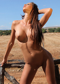 Busty Naked Laura Posing Outdoors