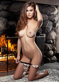 In front of the fireplace