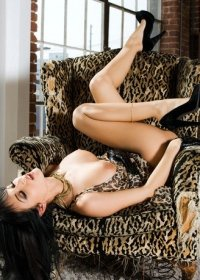 The beautiful Roxanne makes herself very comfortable in several sexy positions on a plush chair