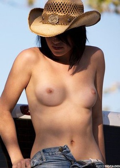 Megan Piper takes her top off in the back of a pickup truck